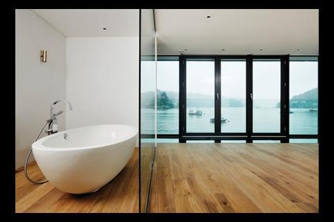 The same view is shared by the master bedrooms and its bathroom behind a clear-glazed screen